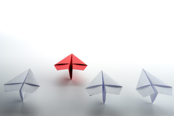 Red paper plane on white background, Business competition and Leadership concept.