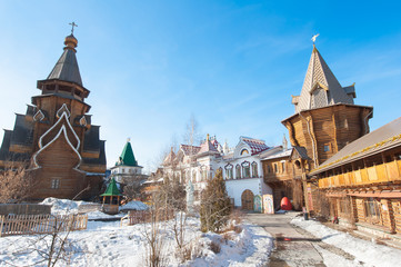Inner yard of Izmailovo Kremlin with rich medieval building and  carving on walls, windows, stairs.