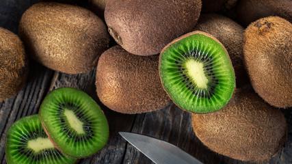 Kiwi fruits on wooden background