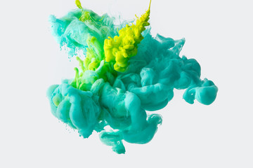 Wall Mural - close up view of mixing of green and bright turquoise paints splashes in water isolated on gray