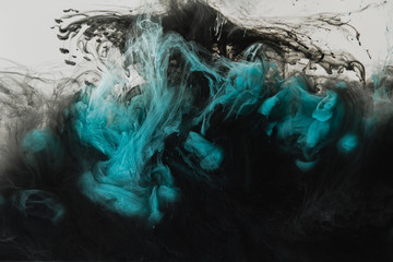 close up view of mixing of light gray, turquoise and black paints splashes in water isolated on gray Wall mural