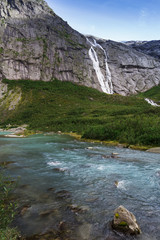 blue glacial water of Briksdal River