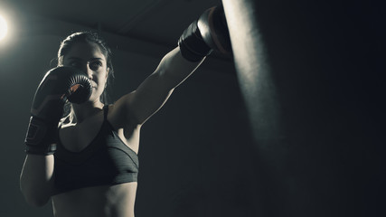 Boxer woman training at the gym