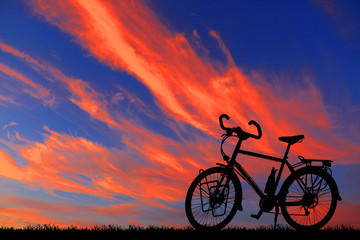 silhouette vintage bike on sunrise
