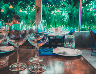 Close up,  picture of empty glasses in restaurant, garden concept.