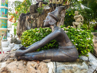 Bangkok, Thailand - Circa January 2018: Statue depicting a Reusi Dat Ton (Thai Yoga) pose at the famous Wat Pho (Buddhist Temple)