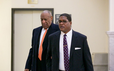 Cosby and spokesperson Wyatt, walk to the courtroom for the Cosby sexual assault retrial in Norristown