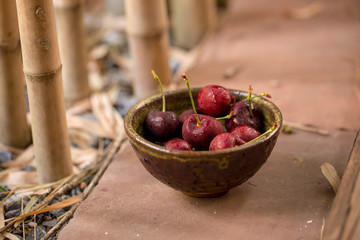 Bowl of Cherries. Red cherries in a bowl on wooden background