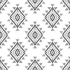 Tribal graphic design. Textured geometric shape in a clean black and white palette. Ethnic seamless pattern for modern home decor. American indian navajo rug.