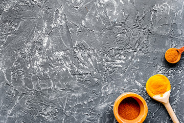 Professional kitchen with spices for cook on gray background top