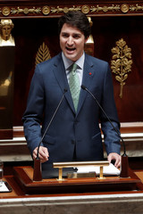 Canadian Prime Minister Justin Trudeau delivers a speech at the National Assembly in Paris