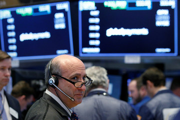 A trader works on the floor of the New York Stock Exchange in the Manhattan borough of New York City