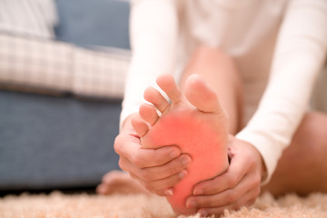foot ankle injury pain women touch her foot painful, healthcare and medicine concept