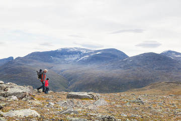 Man with sons hiking in mountain landscape, Jotunheimen National Park, Lom, Oppland, Norway