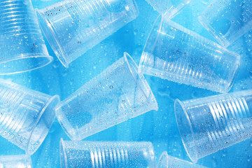 Disposable plastic cups on a blue background