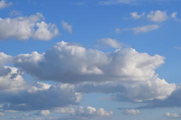 Puffy White Clouds in light Blue Sky