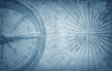Wall Mural - Old vintage retro compass on ancient map. Survival, exploration and nautical theme grunge background