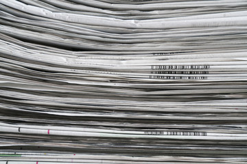 close up newspapers folded and stacked background and texture