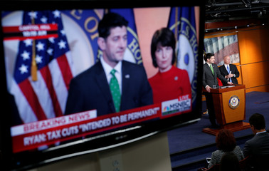 Speaker of the House Ryan (R-WI) is shown speaking on a monitor about tax cuts during a media briefing in Washington