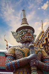 Poster Bangkok Statue of Thotsakhirithon, giant demon (Yaksha) guarding an exit at the Wat Phra Kaew Palace, also known as the Emerald Buddha Temple. Bangkok, Thailand.