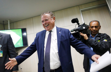 Brazil's Agriculture Minister Blairo Maggi arrives to a news conference in Brasilia
