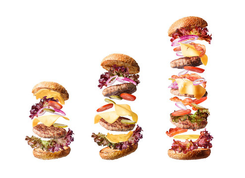 Set of three burgers of different sizes, ordinary, medium and huge. size for every taste. isolate the ingredients of the burger.