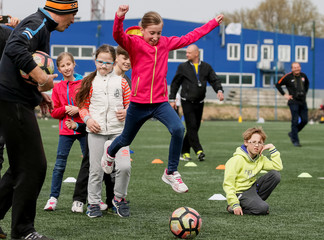 A girl kicks a ball during a practise session of a seminar organised by the FC Shakhtar Donetsk, for soccer training for children with disabilities, near Kiev
