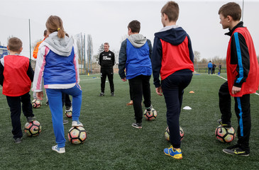 Dornan from Newcastle United Foundation takes part in a practise session of a seminar organised by the FC Shakhtar Donetsk, for soccer training for children with disabilities, near Kiev