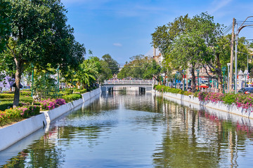Small beautiful bridge over water canal in the centre of Bangkok city, Thailand