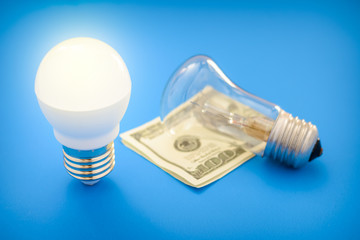 Led light bulb lay next to incandescent bulb