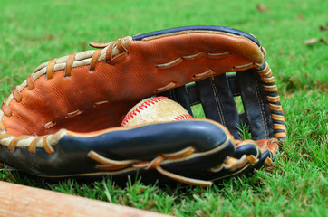 Baseball in glove for sport image, shows ball caught in mitt closeup.  Great ball season or league graphic.