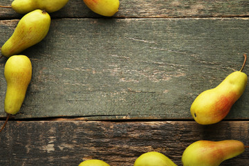 Ripe and sweet pears on grey wooden table