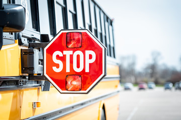 School bus stop sign with flashing lights