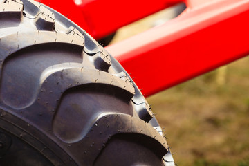 Detailed closeup agricultural machinery, big tires