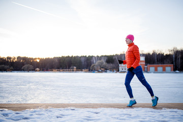 Photo of sports girl on morning exercise in winter