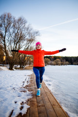 Image of young athlete girl on morning exercise in winter