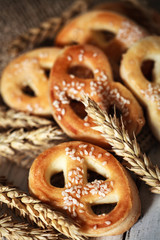 Pretzels with sesame seeds on wooden table