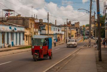 Santa Clara, Cuba: Taxi-motorcycle to transport people in Cuba.
