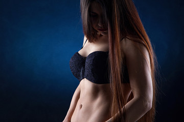 Young woman in black bra