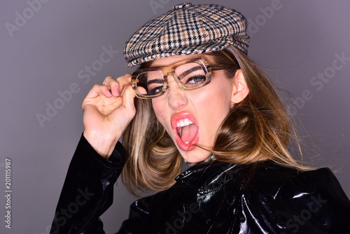 8519e8351fc Woman on scandalized face with make up wears checkered accessories and  glasses for vision. Optics concept. Girl wears kepi