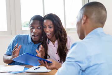 African american couple is happy about offer of agent