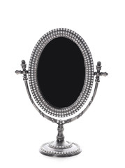 Vintage small mirror on white background