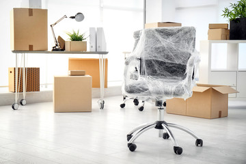 Moving boxes and furniture in new office