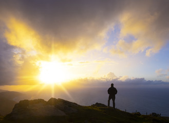 Silhouette Of Man Watching sunset Over Sea, Mount Jaizkibel, Basque Country