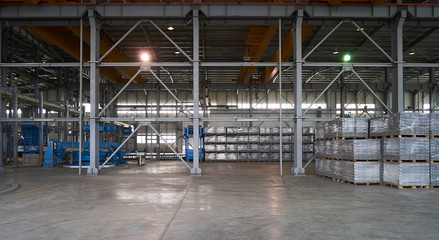 Large warehouse hangar of factory interior. Industry manufacturing concept