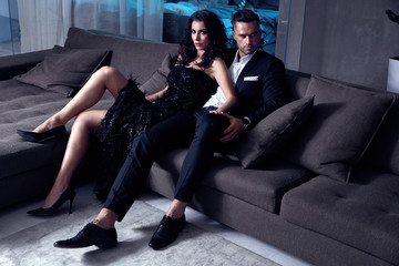 Elegant couple sitting on the couch