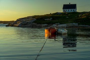 Boats at Peggy's Cove, Nova Scotia at dusk.