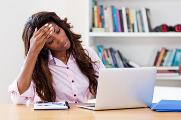 Stressed african american woman at computer
