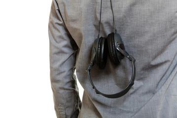 Closeup of headphones hanging upside down