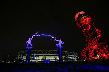 "A posed performance of the ""Lords of Lightening"", part of the upcoming Arcadia show held next to the Orbit Tower in London"